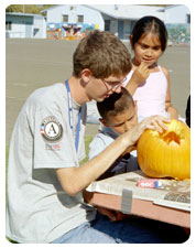 AmeriCorps member with pumpking